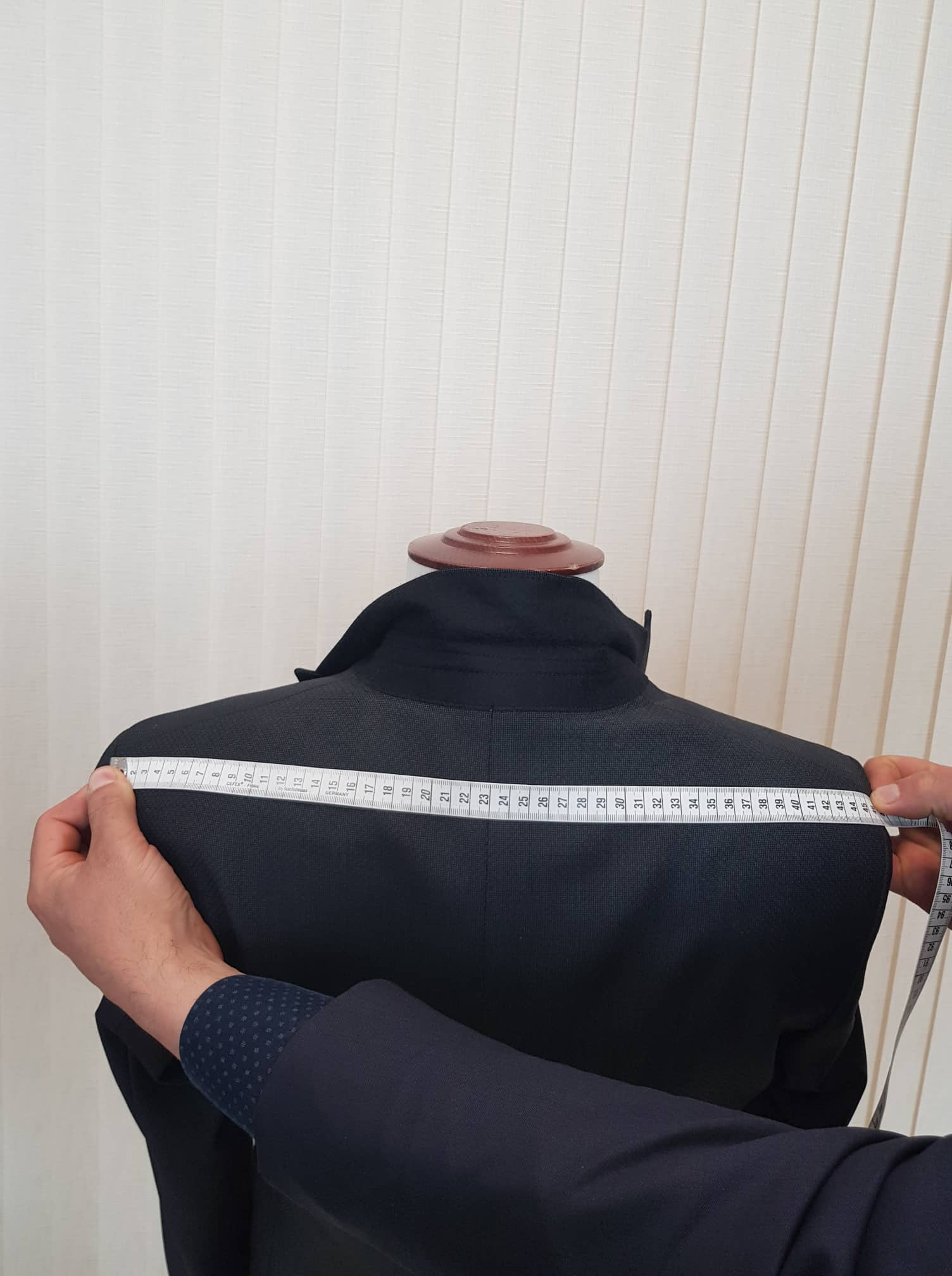 Taking Measurements for a Tailored Suit